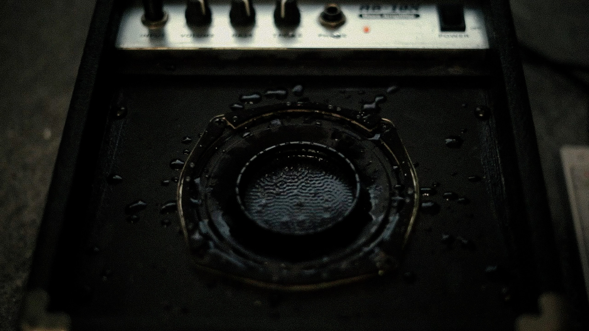 Cymatics are patterns that appear on the surface of a vibrating pool of water, a speaker cone is used here.