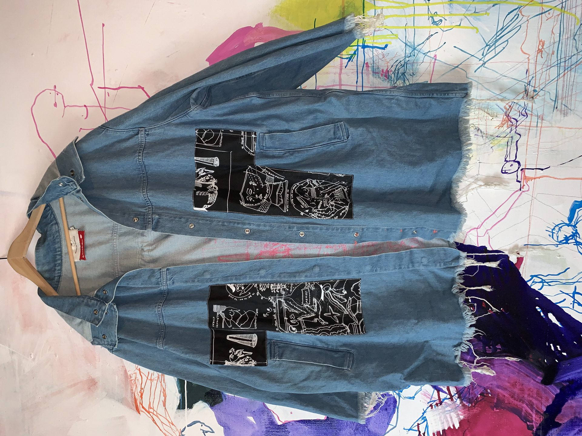 Redesigned denim coat with linen scraps