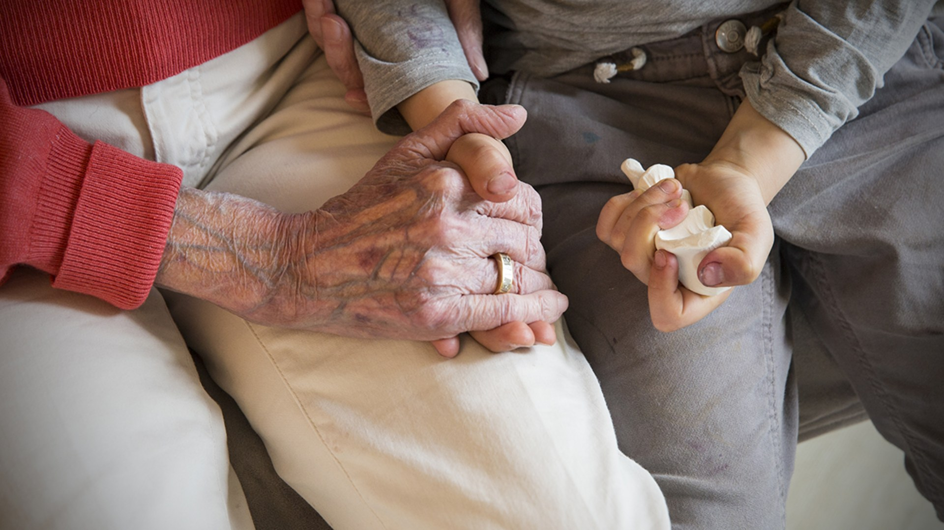 Holding Granny's physical hand and her silicone cast.