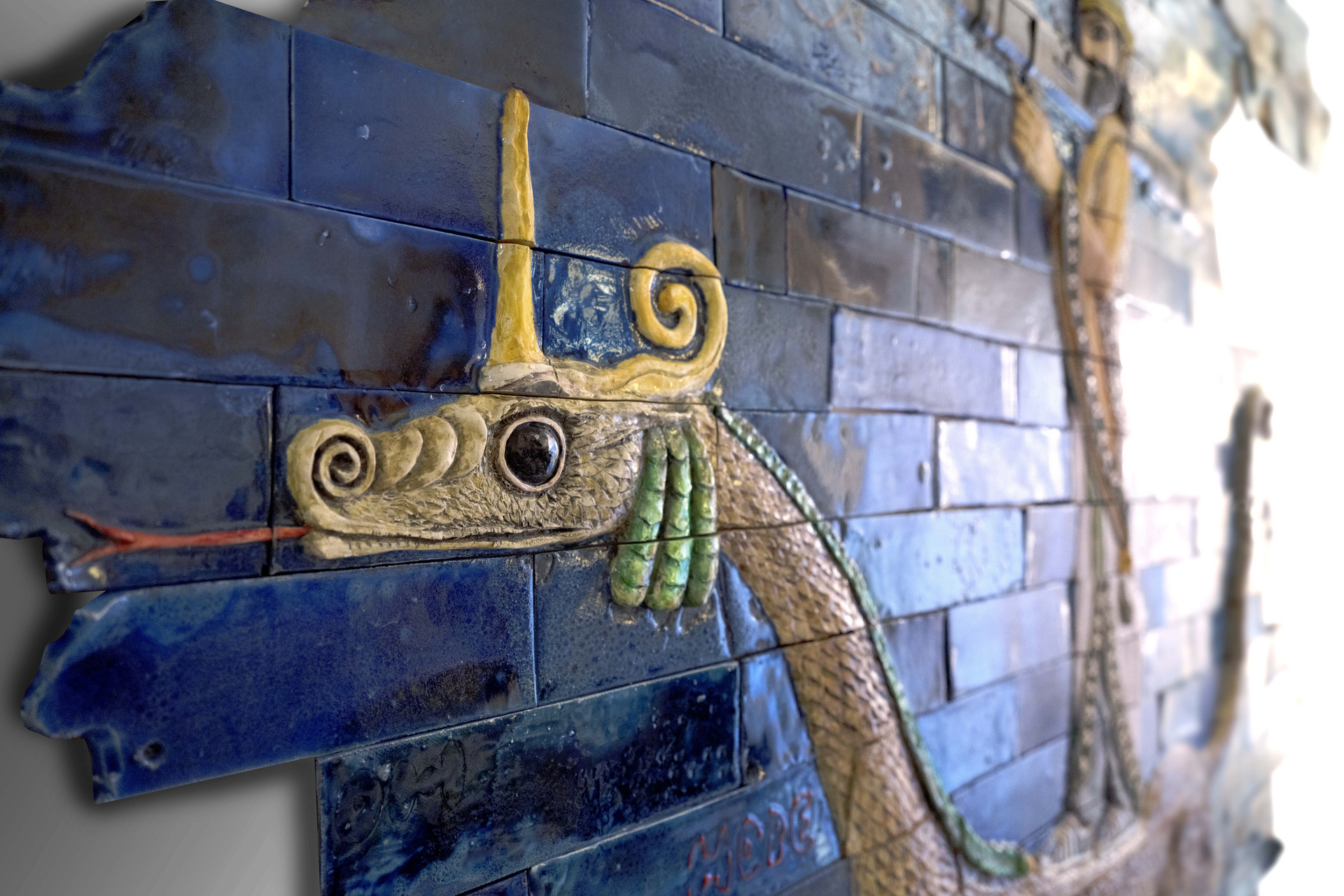 Relief and sculpture of The Beast on the background of a brick wall