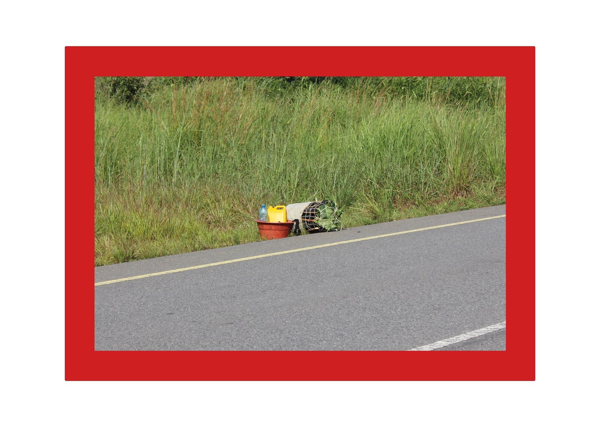 Road in Chitato, Lunda Norte, Angola (plastic basin 2)