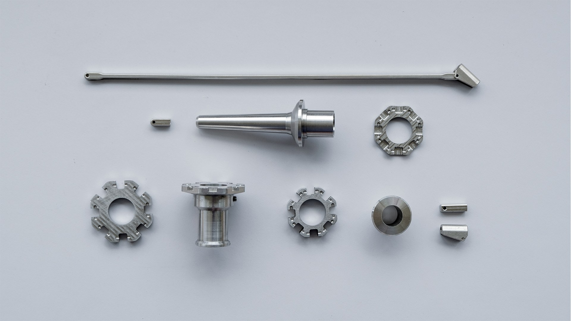 CNC milling was used to create the stainless steel parts.  Total weight of assembled umbrella: 1.71kg.