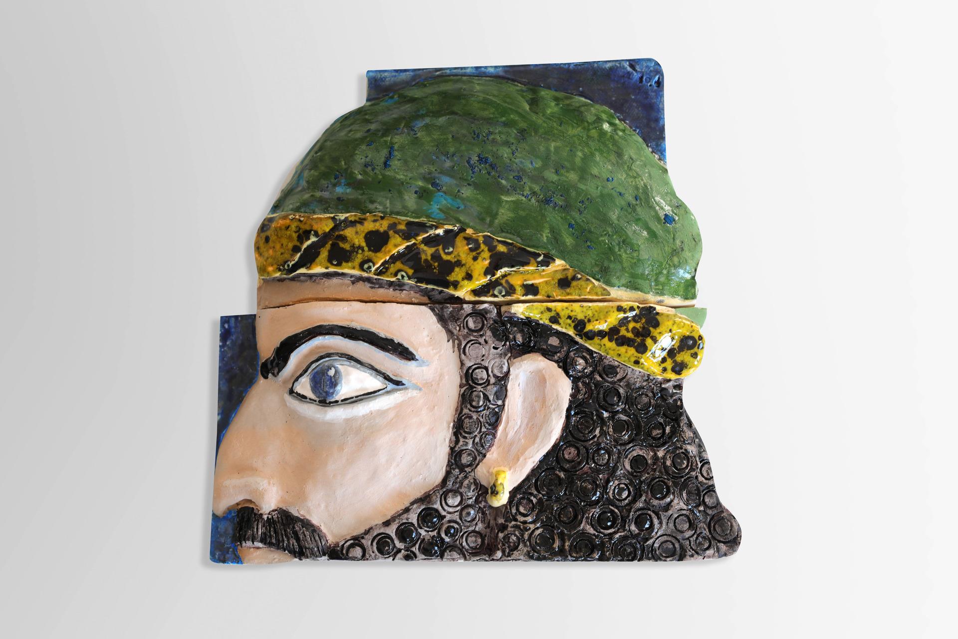 A piece of relief. Warrior head. Souvenir.