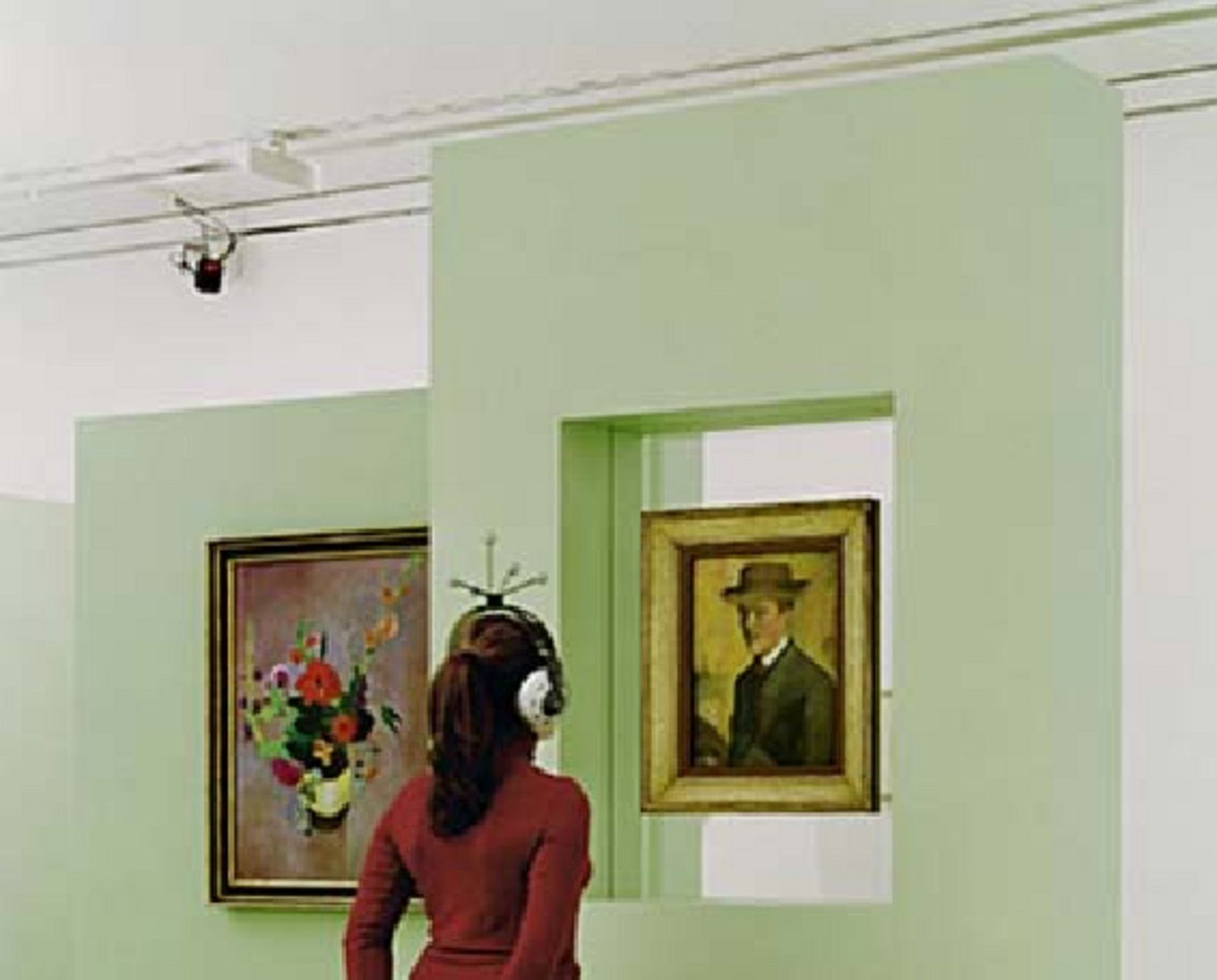 A Visitor with an Adaptive-Augmented Audio Guide in the Macke Laboratory (2003)
