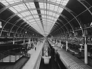A train waiting under the curved roof in Paddington railway station