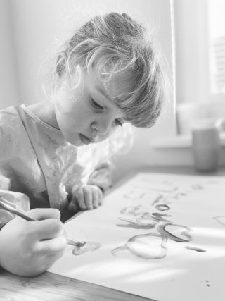 A little girl painting