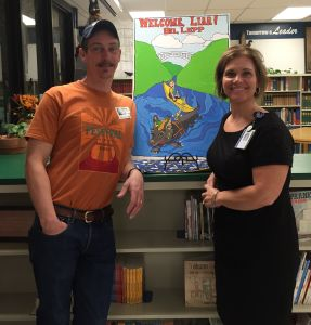 Buckhannon-Upshur librarian Angie Westfall (pictured here with author and story-teller Bill Lep) is drawing students in to the high school's library by appealing to their interests.