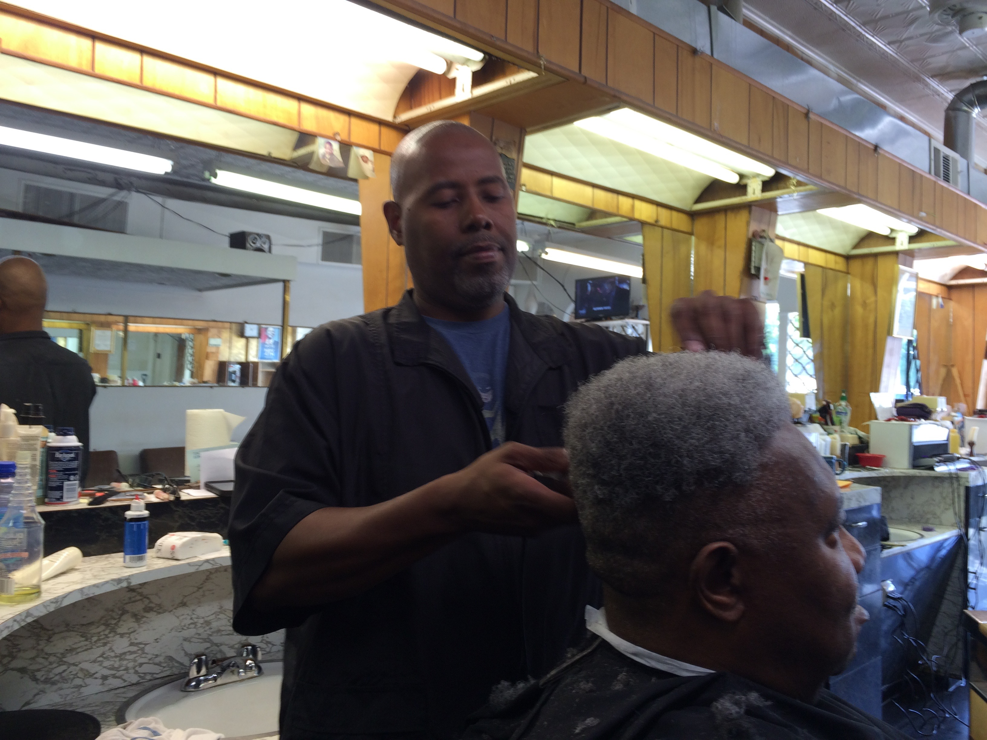 Kenneth Dixon at work in the family business, Dixon's Barber Shop, which has been in existence for three generations. PHOTO CREDIT: Keith A. Owens