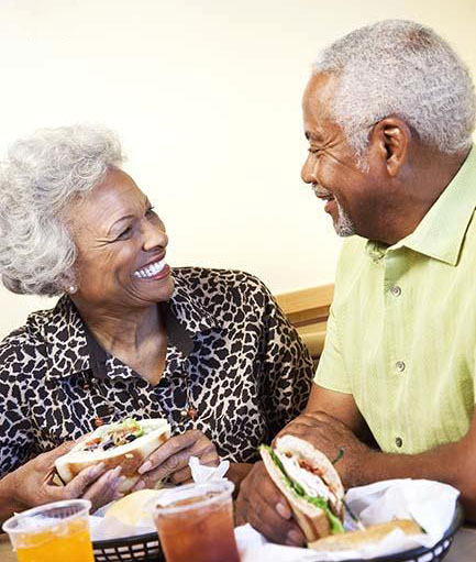 senior african_american_couple_eating_in_bld078880