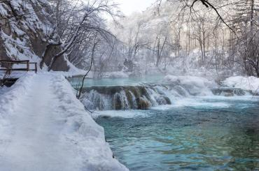 Beautifully frozen, the Plitvice lakes and waterfalls will provide for an enchanting walk