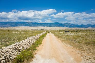 The island of Pag is barren and rocky, with vast empty landscapes. Most of the time you can see Velebit, a towering mountain to the north.