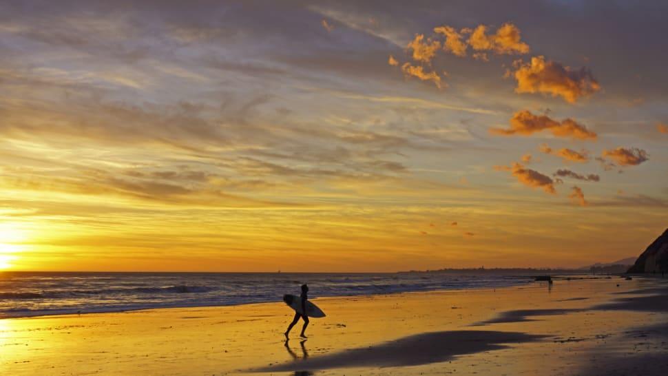 Surfer at Arroyo Burro Beach, Santa Barbara