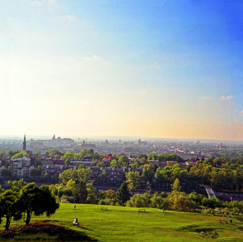 The green fields around the Krakus Mound—panorama of Krakow