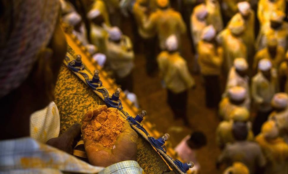 One of the devotees sitting ready with turmeric to throw on the Palkhi