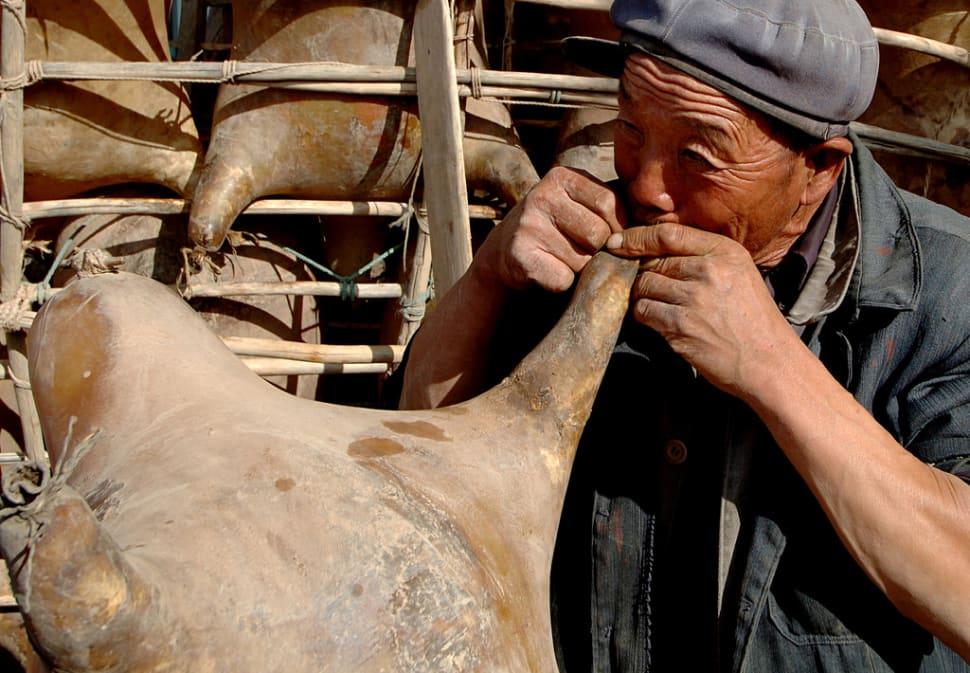 Inflating sheepskins at the Yellow River—Lanzhou , China