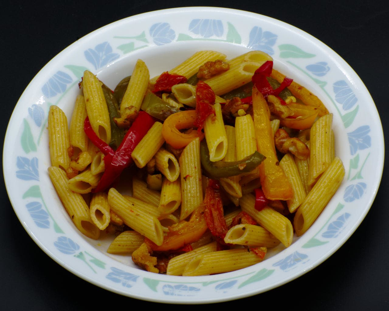 Pasta with assorted capsicum (peppers) and walnuts Image