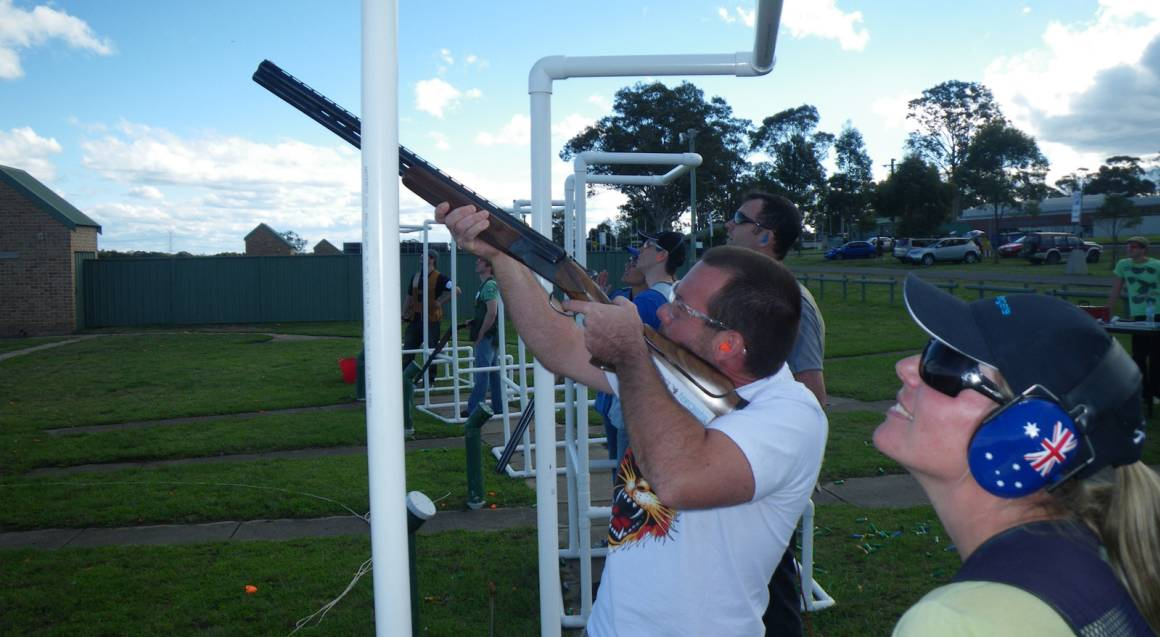 Hitting Targets clay target shooting with live ammo man aiming gun