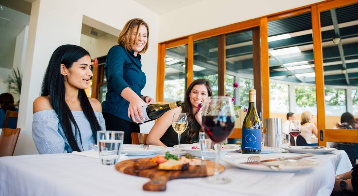 Contentious Character women having lunch and wine