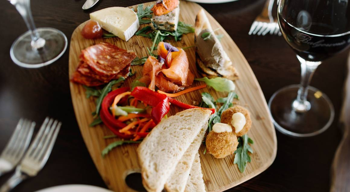 grazing plate of salmon salami bread and cheese