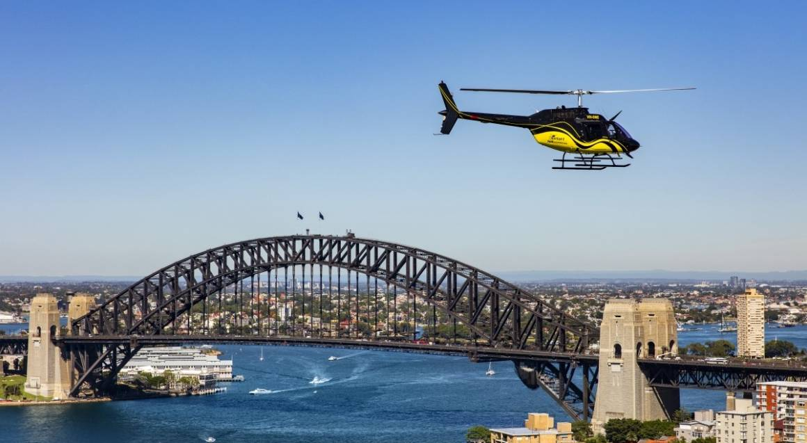 Helicopter flying in front of the Sydney Harbour Bridge