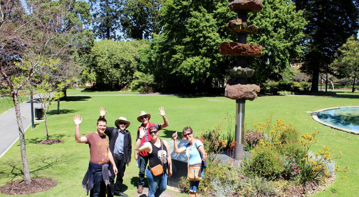 tour group posing for a photo in a park
