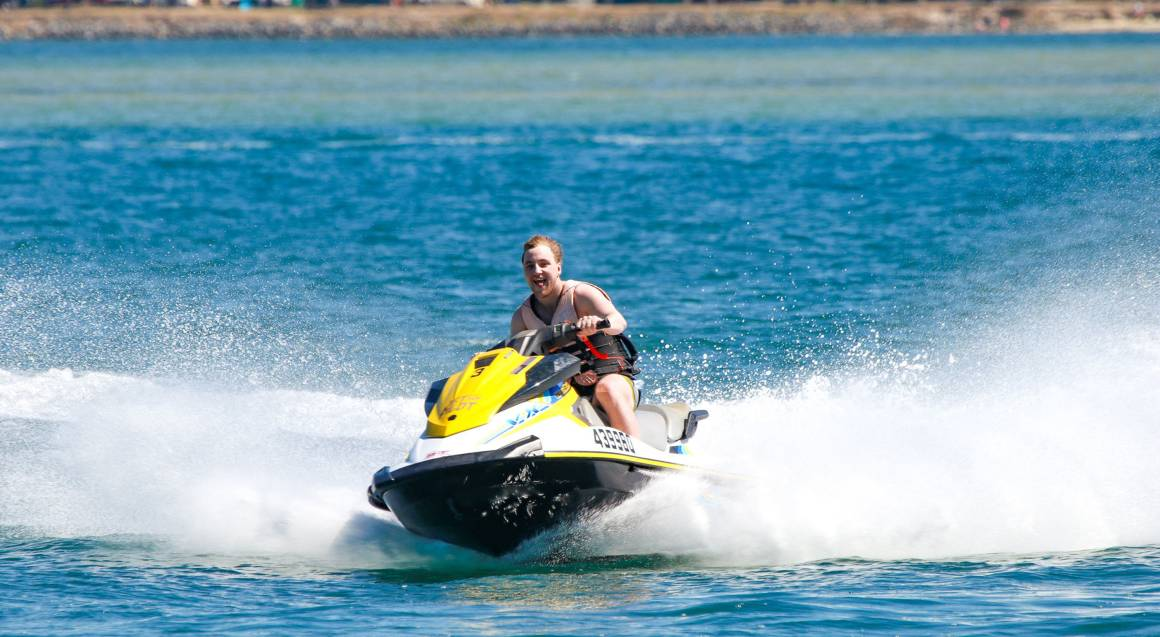 boy riding on jet ski ocean south stradbroke island