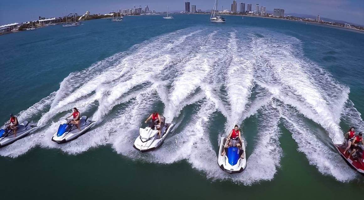 group of jet skis riding in ocean