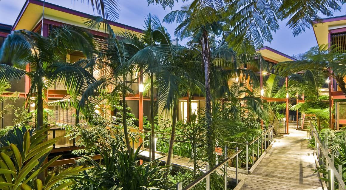 byron ay byron resort entrance way set amongst palm trees