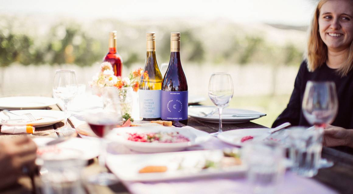Contentious Character outdoor lawn table with wine and food