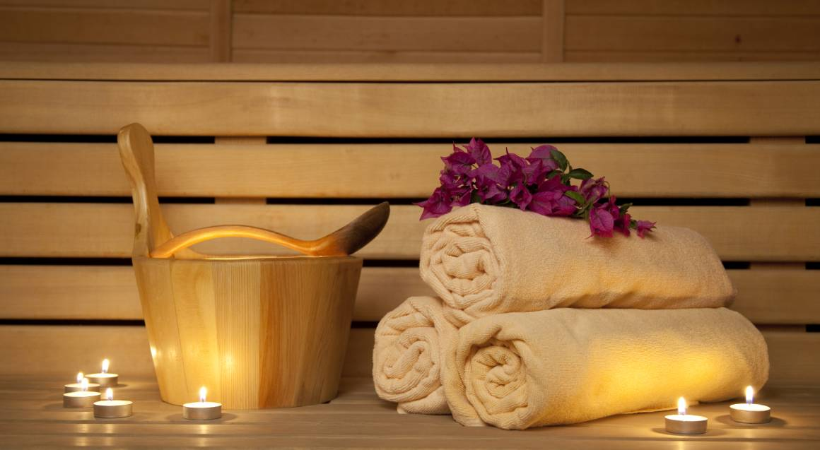 inside spa infrared sauna with towels and flowers