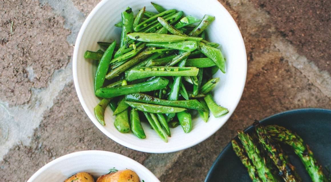 bowl of marinated peas potatoes and asparagus