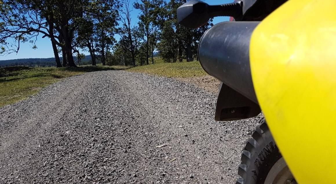 Dirt bike hire Sunshine Coast Queensland dirt road track yellow motorbike