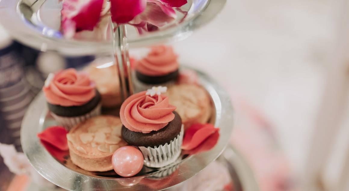 The Tea Salon high tea cupcake tray display with rose petals