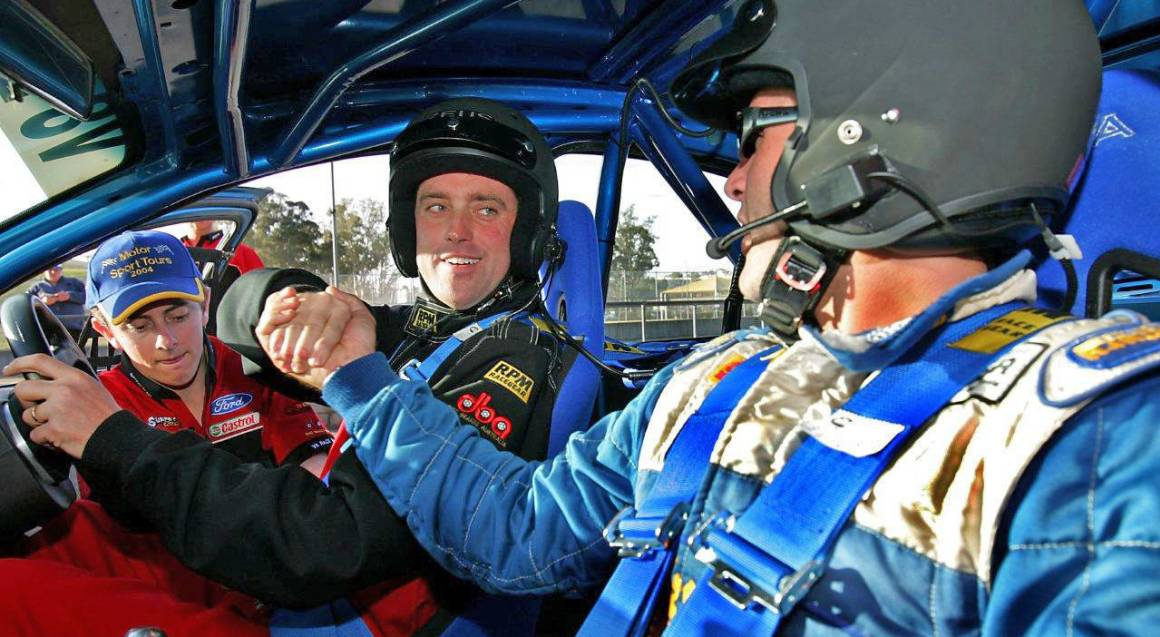 man and instructor in v8 race car on hidden valley track