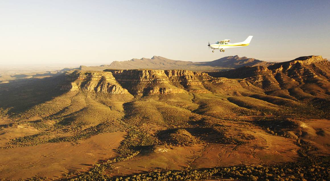 light aircraft flying over wilpena pound in flinders ranges