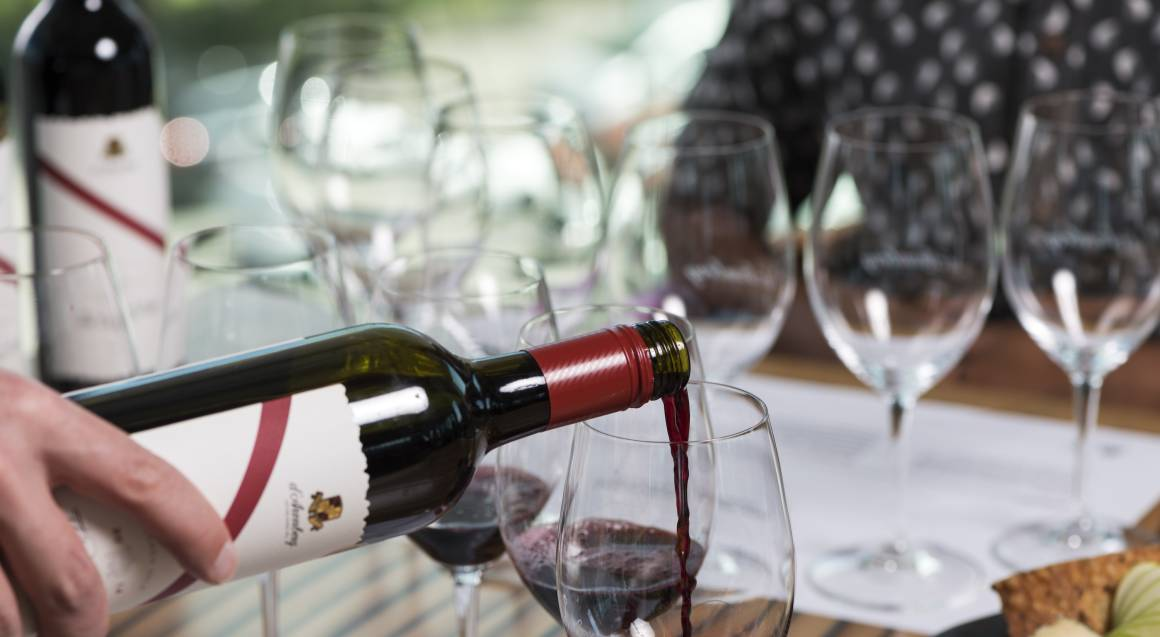 pouring glass of red wine at a wine tasting session at d'arenberg winery