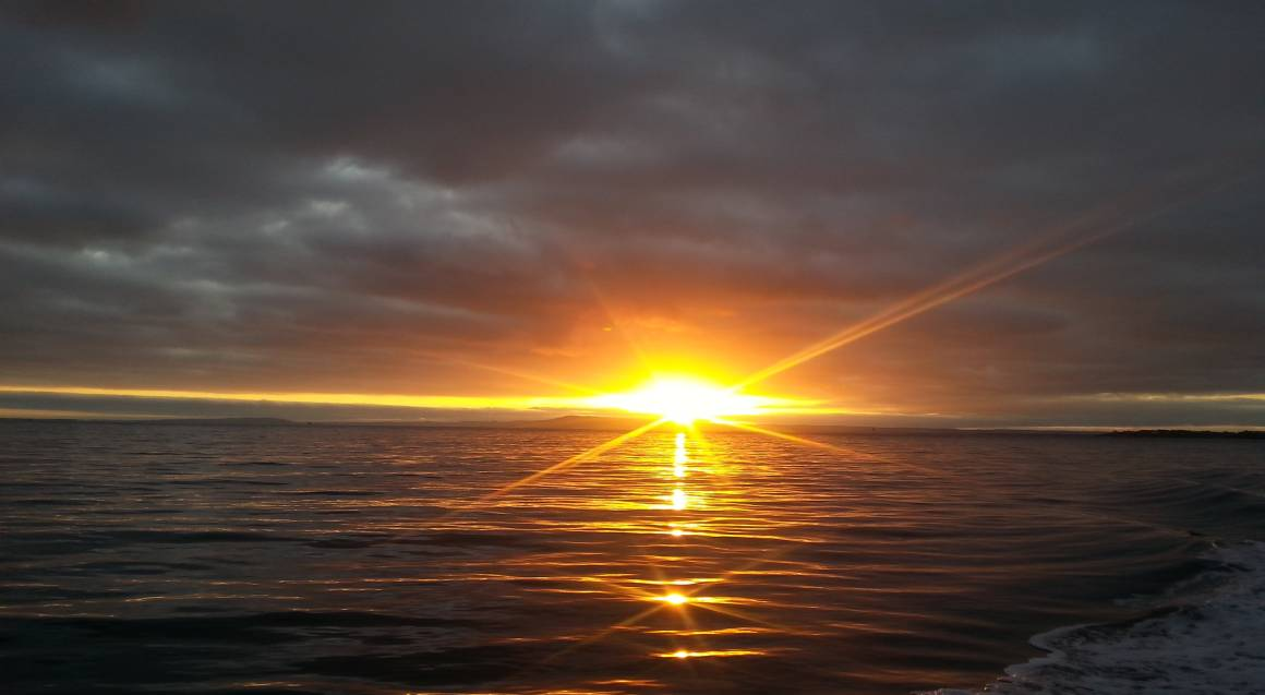 fishing trip sport sunset beach in background
