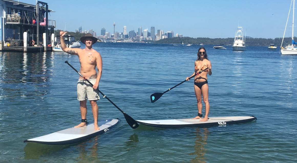 couple Stand Up Paddle boarding on Sydney Harbour