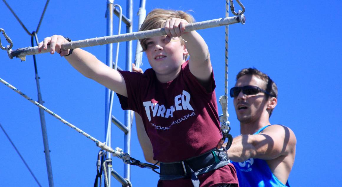 Circus Arts Brisbane boy on flying trapeze