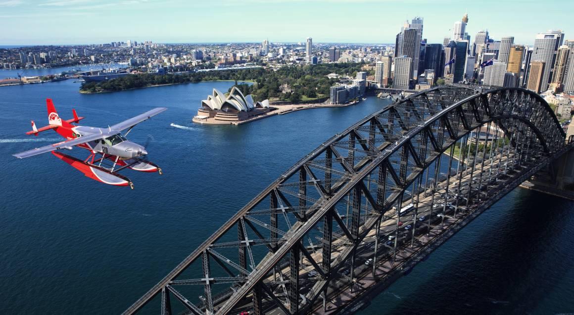 Seaplane aerial view of sydney harbour bridge and opera house