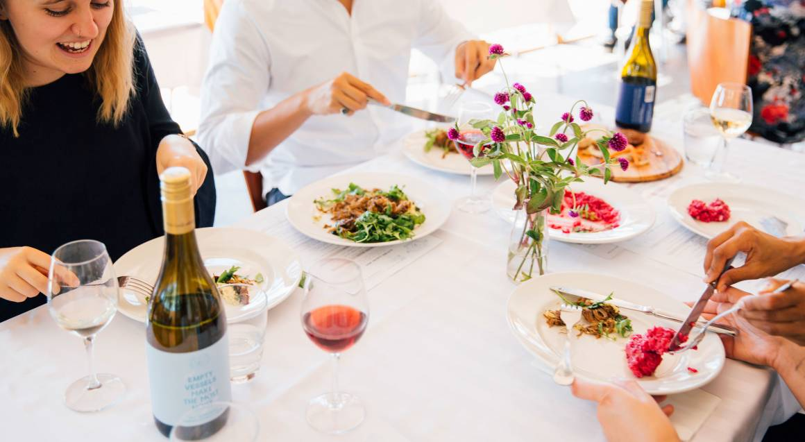 Contentious Character people eating lunch with wine