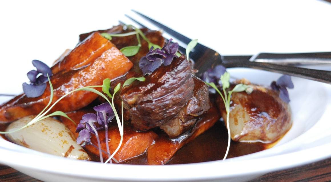 slow cooked lamb beef with roasted vegetables