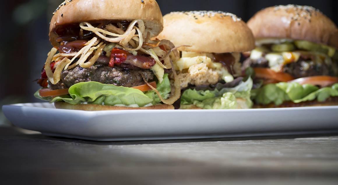 three burgers on plate