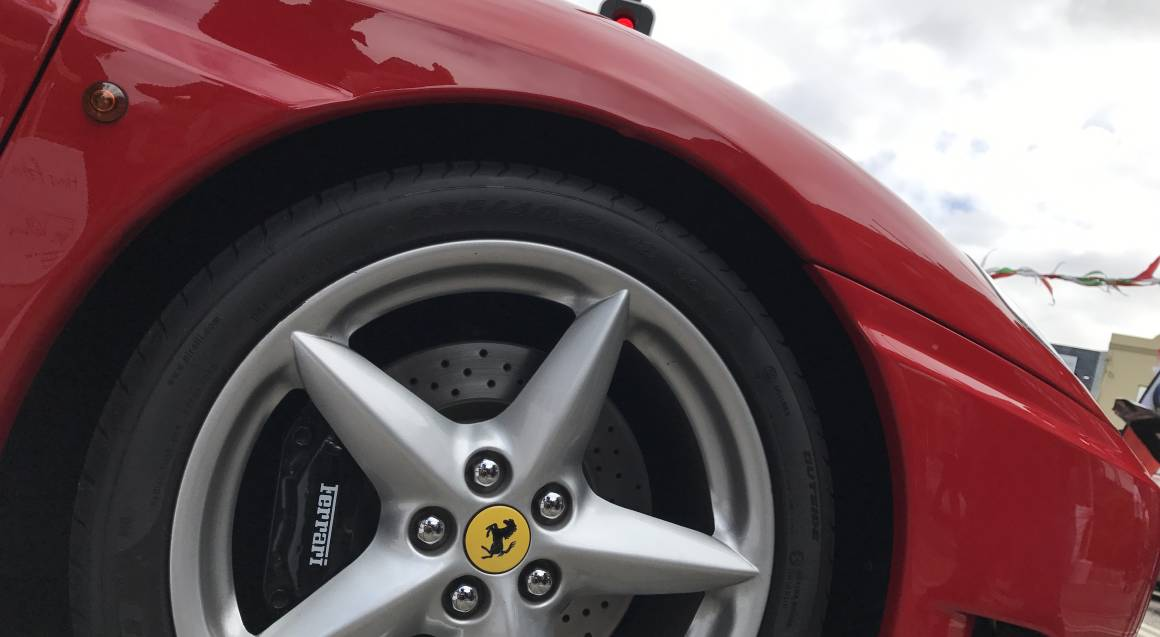 Fuga Veloce red ferrari 360 spider closeup view of wheel