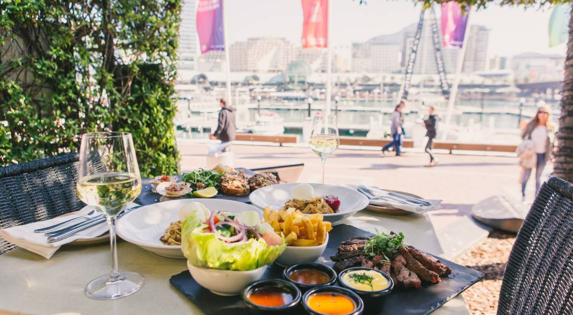 mediterranean three course feast platters with wine by the harbour