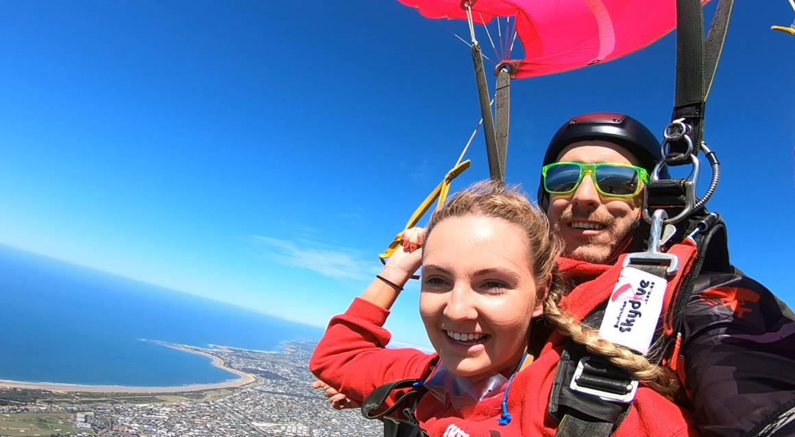 woman and instructor tandem skydiving over great ocean road