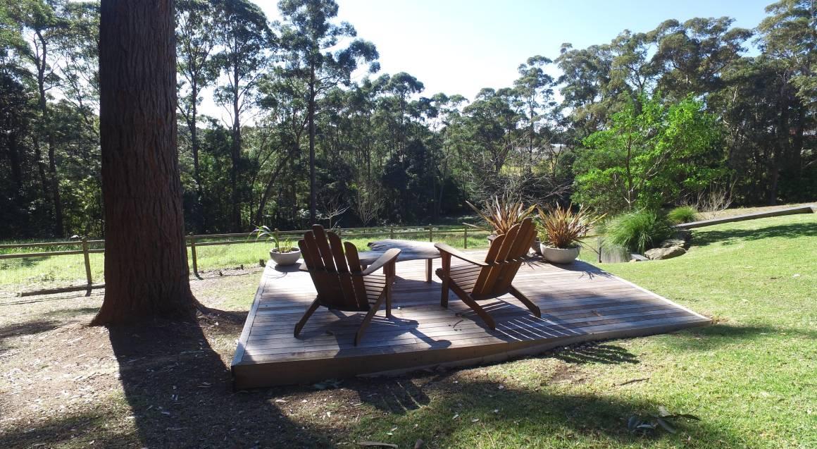 garden chairs overlooking trees