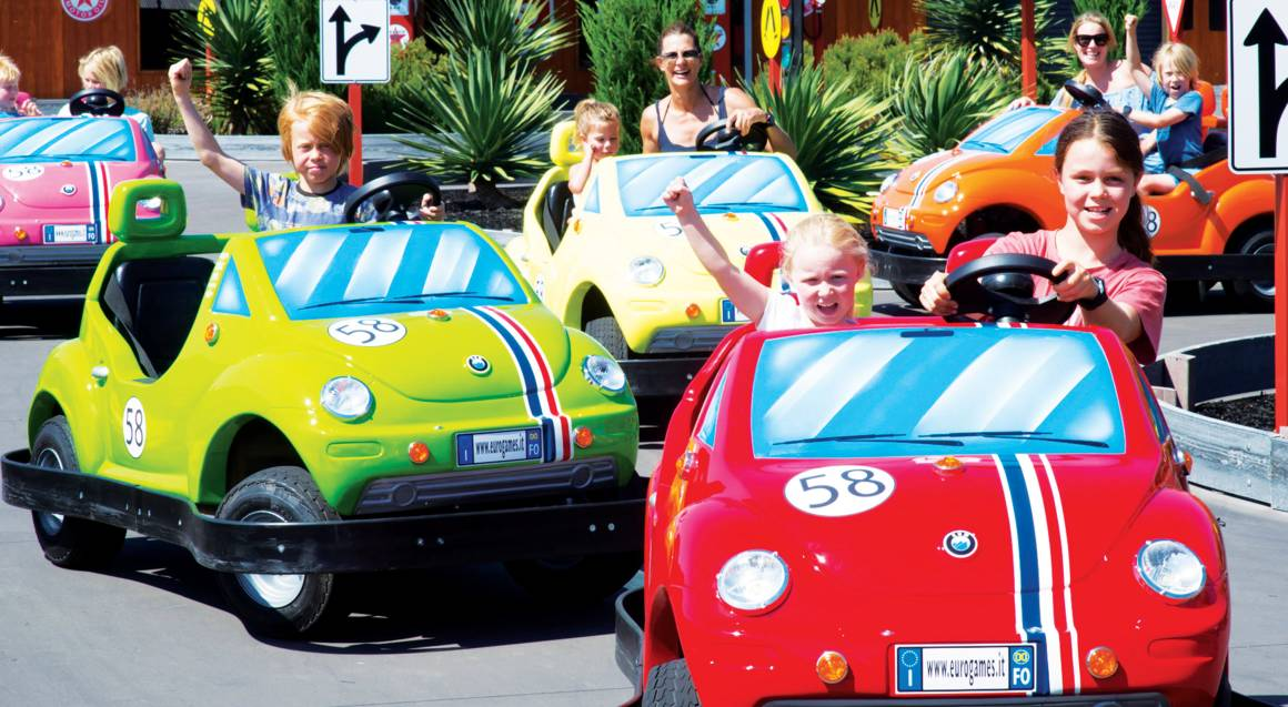 children driving go karts at adventure park