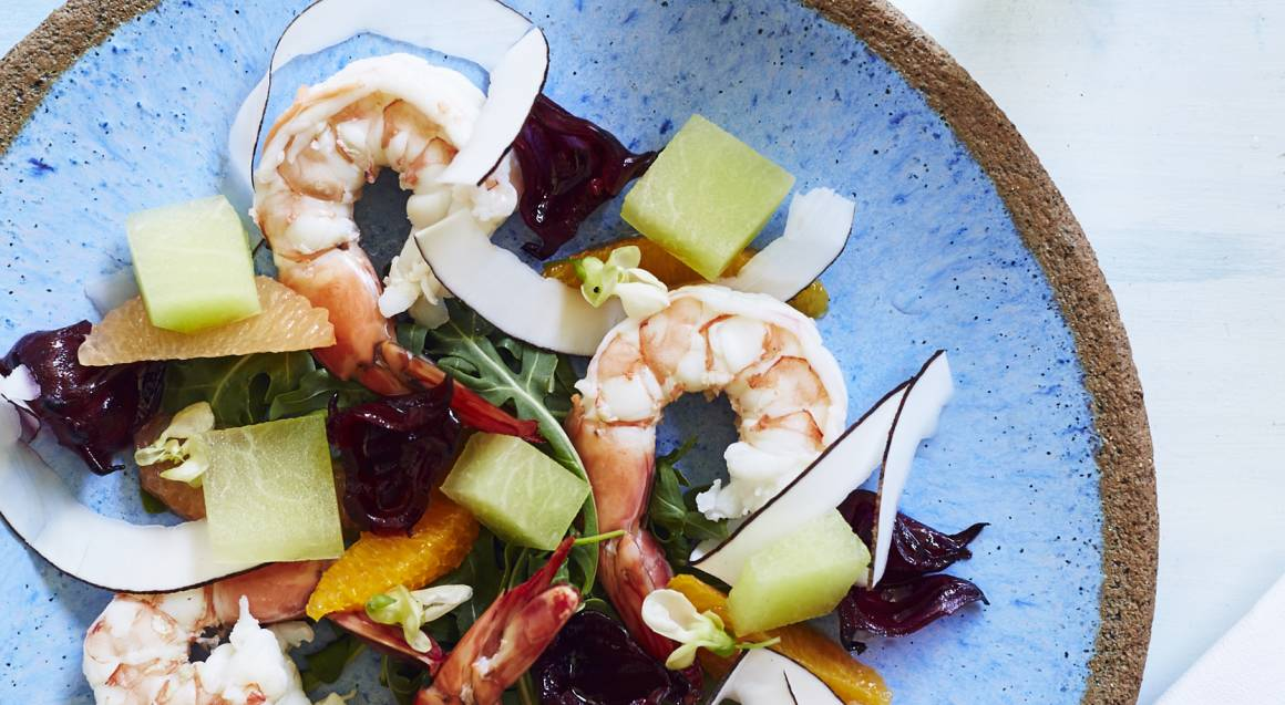 blue plate of fruit and vegetables with prawns