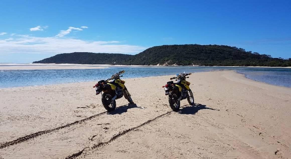 Dirt bike hire Sunshine Coast Queensland beach view and yellow motorbikes